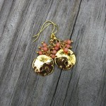 Sand dollar earrings in gold
