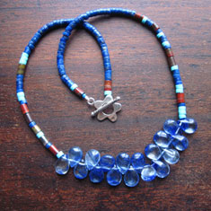 Lapiz lazuli and carneilan heishi beads with glass teardrops necklace Necklace