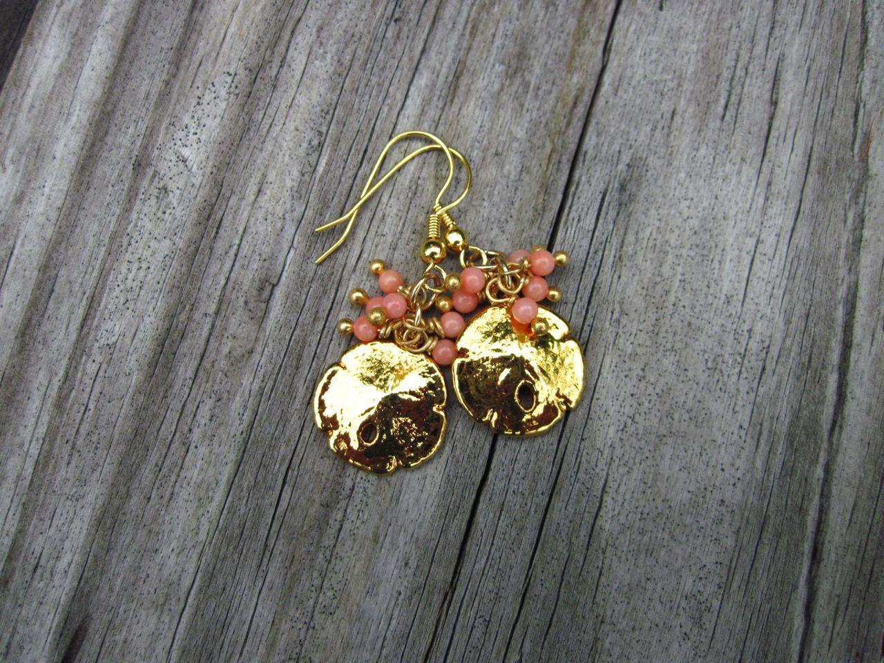 Sand dollar earrings in gold